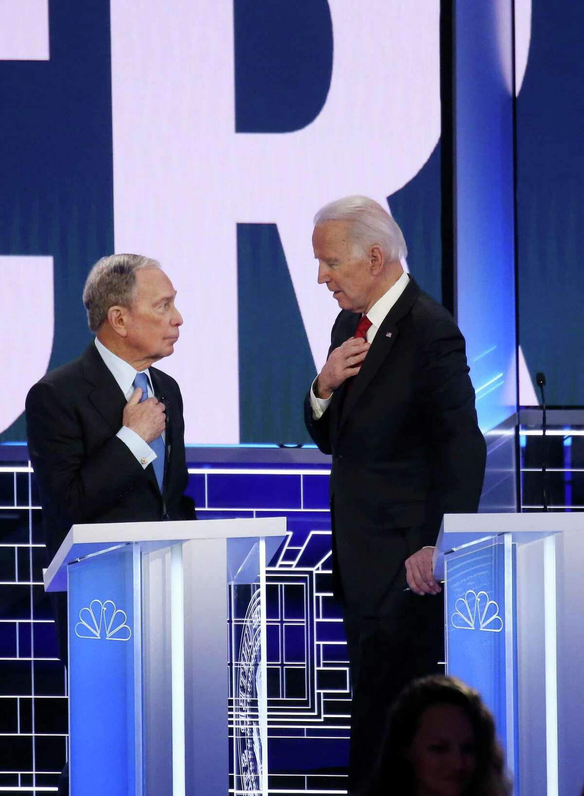 LAS VEGAS, NEVADA - FEBRUARY 19: Democratic presidential candidates former New York City mayor Mike Bloomberg (L) and former Vice President Joe Biden speak during a break during the Democratic presidential primary debate at Paris Las Vegas on February 19, 2020 in Las Vegas, Nevada. Six candidates qualified for the third Democratic presidential primary debate of 2020, which comes just days before the Nevada caucuses on February 22. (Photo by Mario Tama/Getty Images)