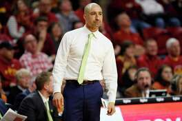 Texas head coach Shaka Smart watches from the bench during the second half of an NCAA college basketball game against Iowa State, Saturday, Feb. 15, 2020, in Ames, Iowa. Iowa State won 81-52. (AP Photo/Charlie Neibergall)