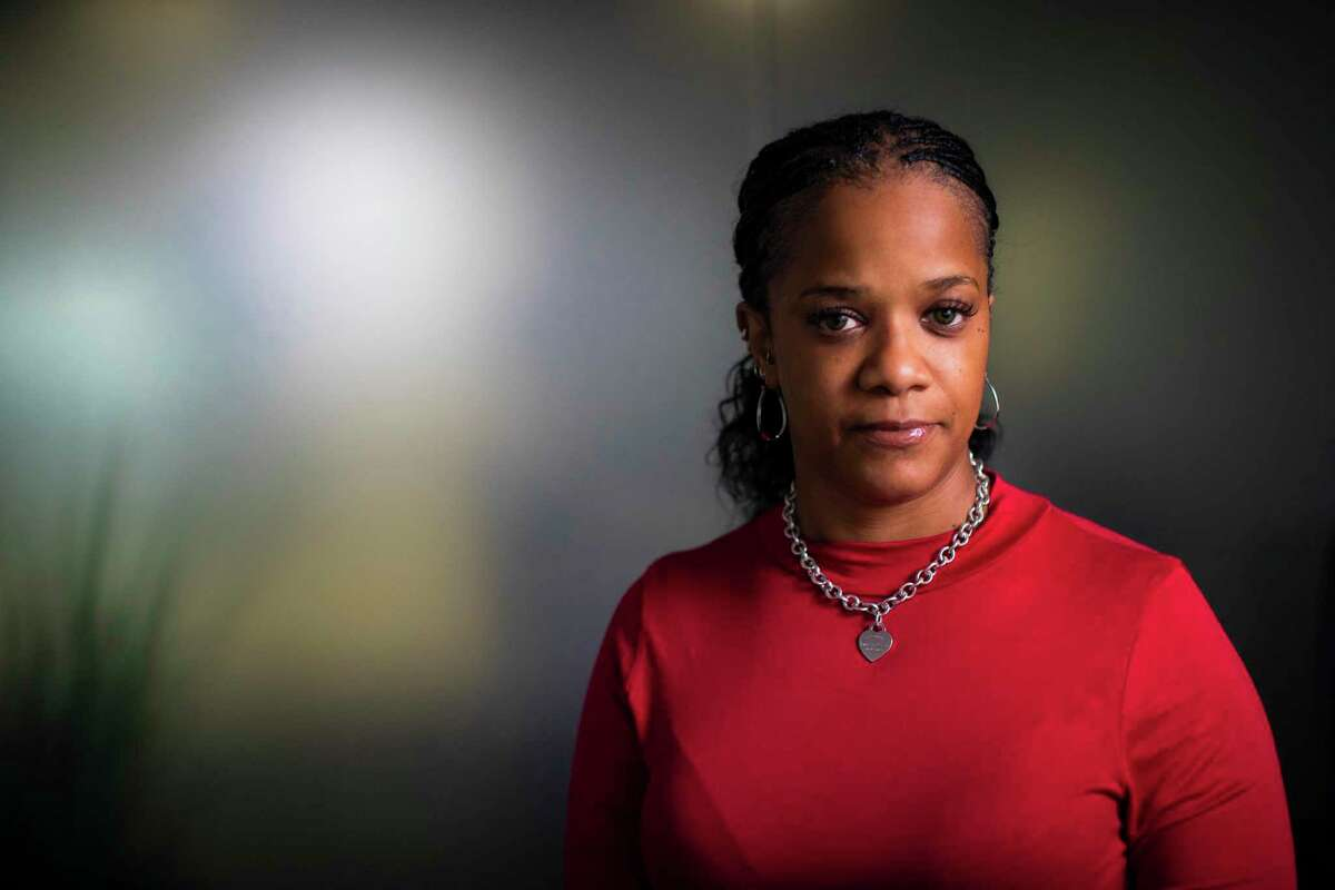 LaSonthia Sandles, whose mother, Christine Rollins, authorities said was killed by feral hogs late last year in Anahuac, poses for a portrait at her lawyer's office on Monday, Feb. 3, 2020, in Houston.