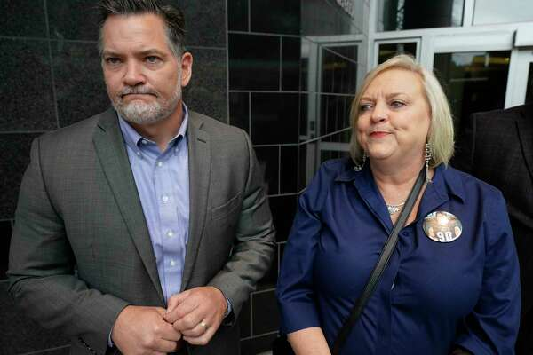 """Mical Padgett and his wife, Wyndi Padgett, speak to the media about their late son Blain Padgett outside the Bob Casey United States Courthouse, 515 Rusk St., Thursday, Feb. 20, 2020, in Houston. Stuart """"Mooch"""" Mouchantaf, a former Rice University football player, charged in the 2018 opioid-induced death of Blain Padgett, pleaded guilty to conspiracy to possess with the intent to distribute causing death and possession with the intent to distribute causing death."""