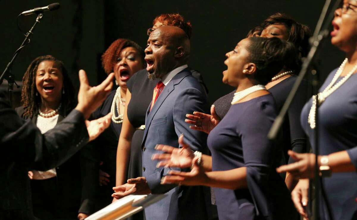 The gospel ensemble from Resurrection Church performs the National Anthem at the investiture ceremony for Jason K. Pulliam, the first African-American appointed as a federal judge in the U.S. District Court's Western District of Texas. Pulliam, 48, is also the district's youngest member of the federal judiciary.