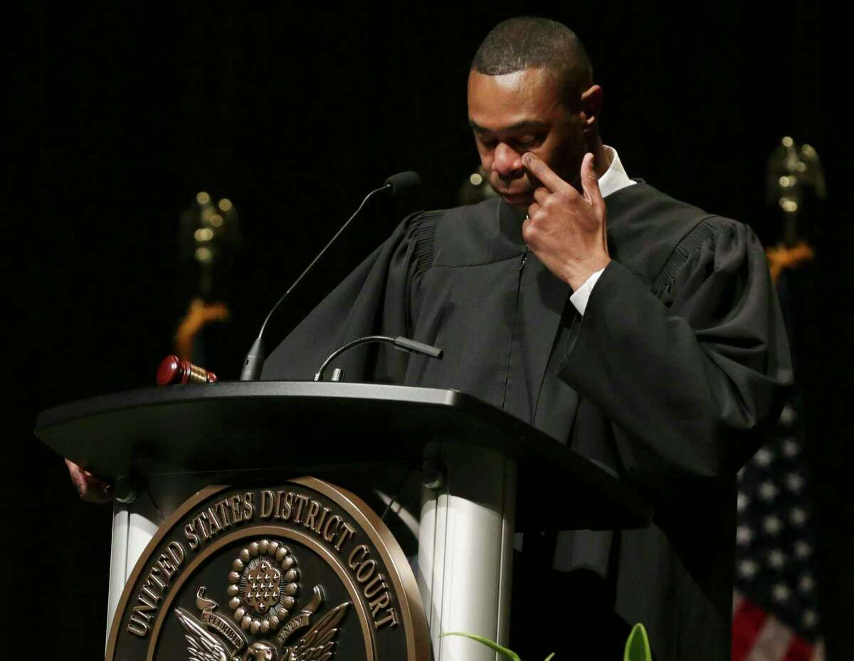 Jason K. Pulliam, the first African-American appointed as a federal judge in the U.S. District Court's Western District of Texas, becomes tearful while paying tribute to his mother, who was in the audience for his investiture ceremony at the Lila Cockrell Theatre on Thursday.