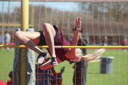 With little room to spare, Deer Park's Brianna Eliassen clears the bar at 5 feet during the high jump competition at the Brown Relays. Eliassen brought home the bronze medal.