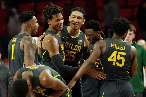 Baylor's Mark Vital, from left, Freddie Gillespie, Tristan Clark, Devonte Bandoo and Davion Mitchell celebrate the top-ranked Bears' Big 12 record-setting 23rd consecutive victory, a 65-54 triumph at Oklahoma on Tuesday. Up next Saturday: a home matchup with No. 3 Kansas.