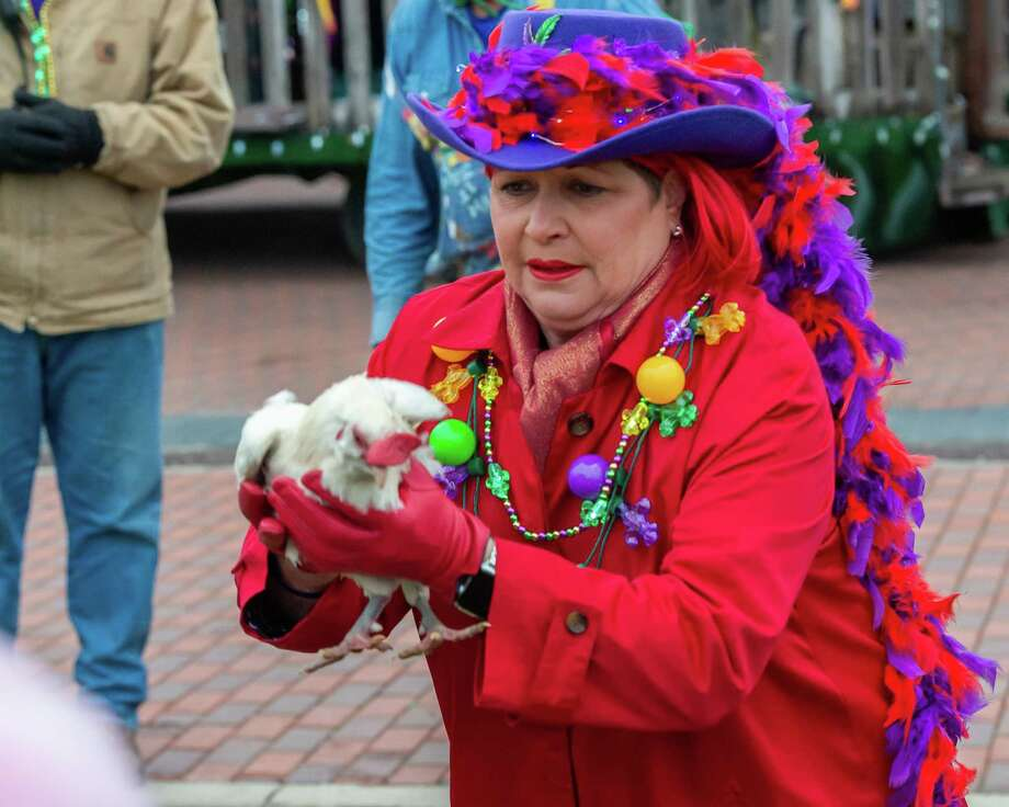 Beaumont mayor Becky Ames releases Fred the Chicken for the traditional chicken chase as Mardi Gras in Southeast Texas kicked off with Courir de Mardi Gras with the chicken toss and chase in rural Louisiana style at the downtown Event Centre on Thursday, February 20, 2020. Fran Ruchalski/The Enterprise Photo: Fran Ruchalski/The Enterprise / 2019 The Beaumont Enterprise