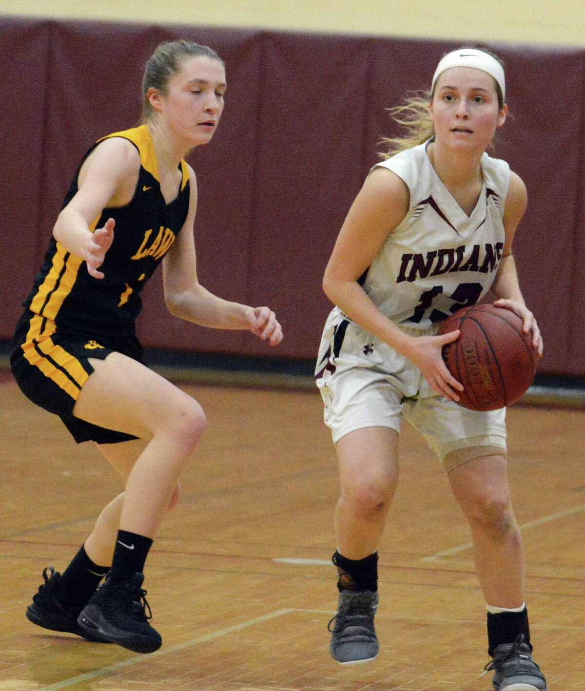 North Haven's Laura Petrefesa looks to pass during the first round of the SCC tournament against Law on Thursday.