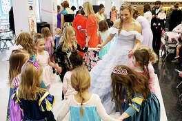 In this February 2018 file photo, a princess talks with young girls during last year's Tea Party Fundraiser for the Edwardsville High School Medical Occupations Club.