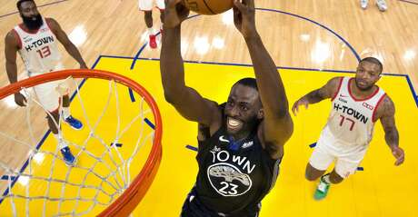 Draymond Green (23) goes in for a dunk In the first half as the Golden State Warriors played the Houston Rockets at Chase Center in San Francisco, Calif., on Wednesday, December 25, 2019. The Warriors defeated the Rockets 116-104
