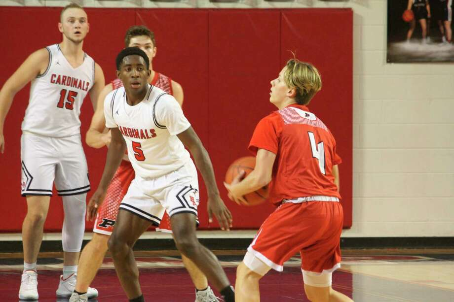 Big Rapids' Demarcus Lee (5) and the Cardinals are looking for a key win tonight.(Pioneer file photo)