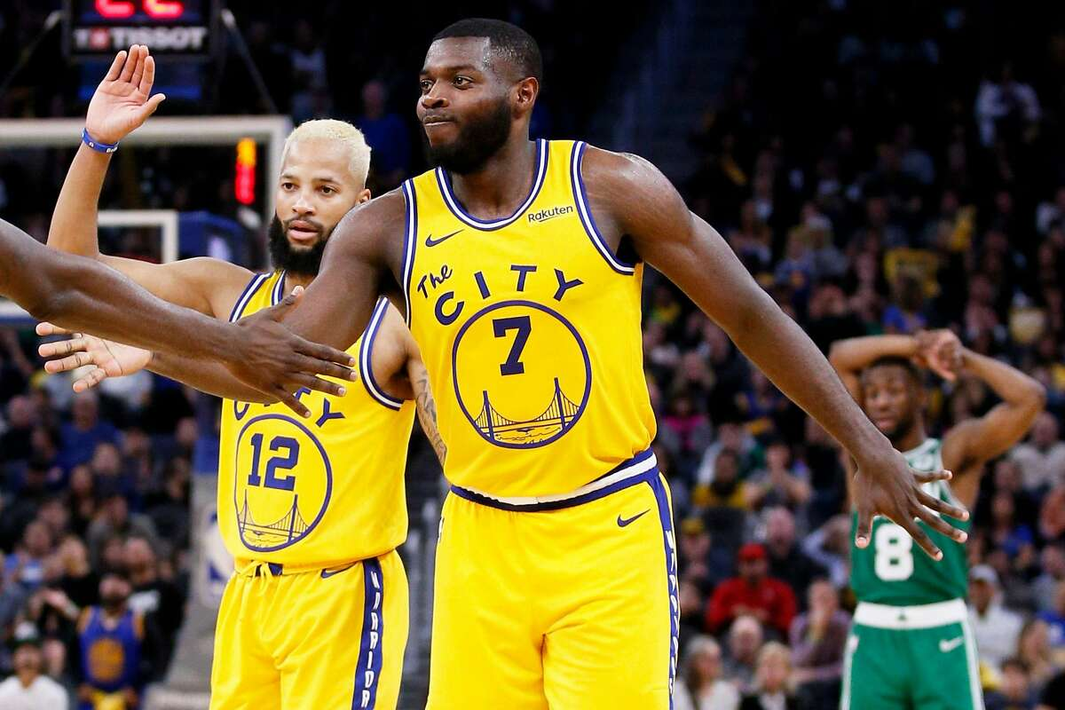 Golden State Warriors forward Eric Paschall (7) and guard Ky Bowman (12) commend teammates in the second half of an NBA game against the Boston Celtics at Chase Center on Friday, Nov. 15, 2019, in San Francisco, Calif.