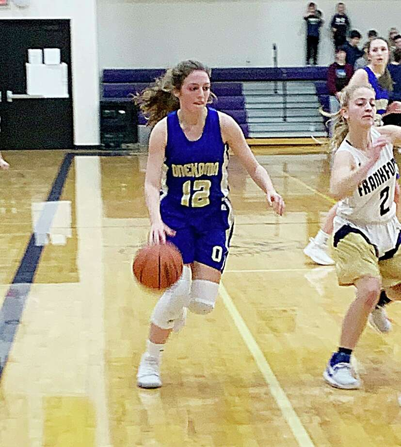 Onekama's Ella Acton dribbles down the court during the Portagers' game against Frankfort on Thursday. (Courtesy photo)