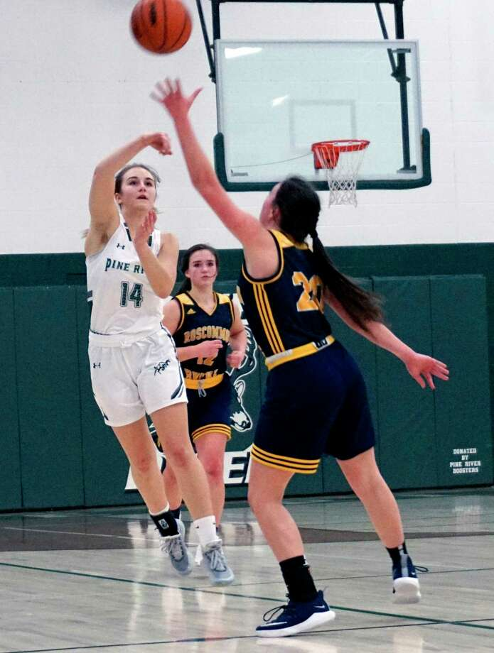 Freshman Madi Sparks of Pine River avoids an opponent while she makes a long pass down the court during PR's 42-24 win over Roscommon on Thursday night. (Pioneer photo/Joe Judd)