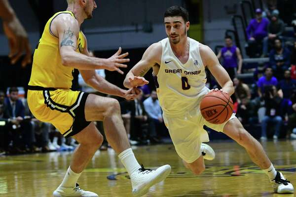 University at Albany's Antonio Rizzuto drives to the basket against Maryland-Baltimore County's Dimitrije Spasojevic during a game at SEFCU Arena on Thursday, Feb. 20, 2020 in Albany, N.Y. (Lori Van Buren/Times Union)