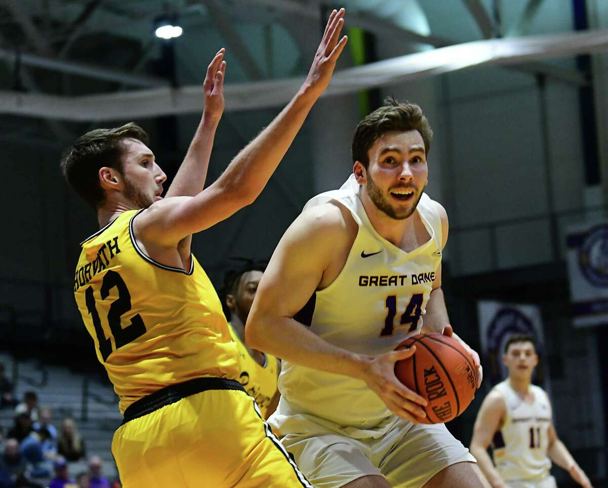 University at Albany's Adam Lulka drives to the basket against Maryland-Baltimore County's last season. Lulka is looking to stay healthy for the rest of this season. (Lori Van Buren/Times Union)