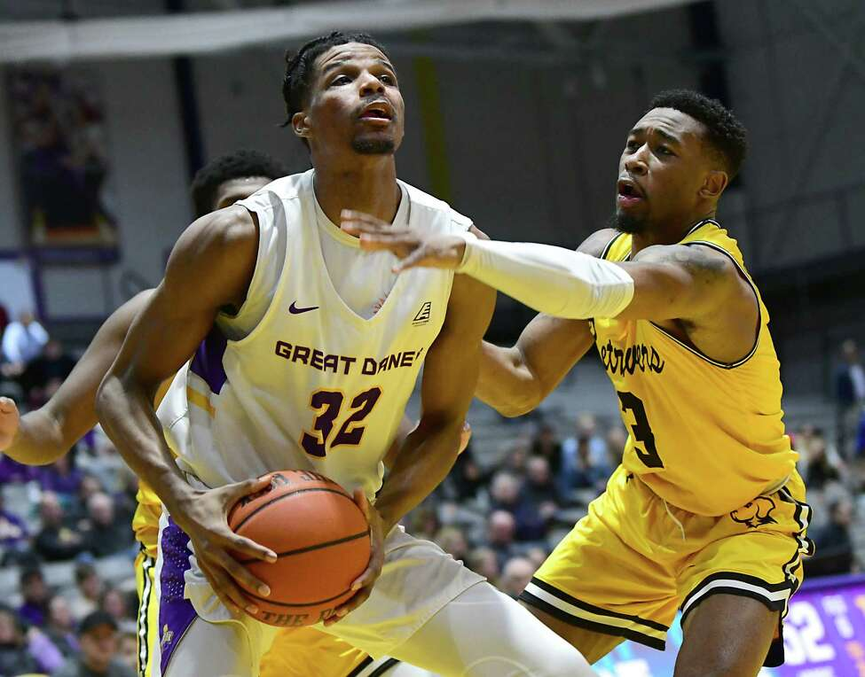 University at Albany's Romani Hansen drives to the basket against Maryland-Baltimore County's K.J. Jackson during a game at SEFCU Arena on Thursday, Feb. 20, 2020 in Albany, N.Y. (Lori Van Buren/Times Union)