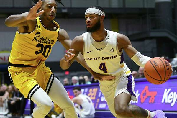 University at Albany's Ahmad Clark drives to the basket against Maryland-Baltimore County's Daniel Akin during a game at SEFCU Arena on Thursday, Feb. 20, 2020 in Albany, N.Y. (Lori Van Buren/Times Union)