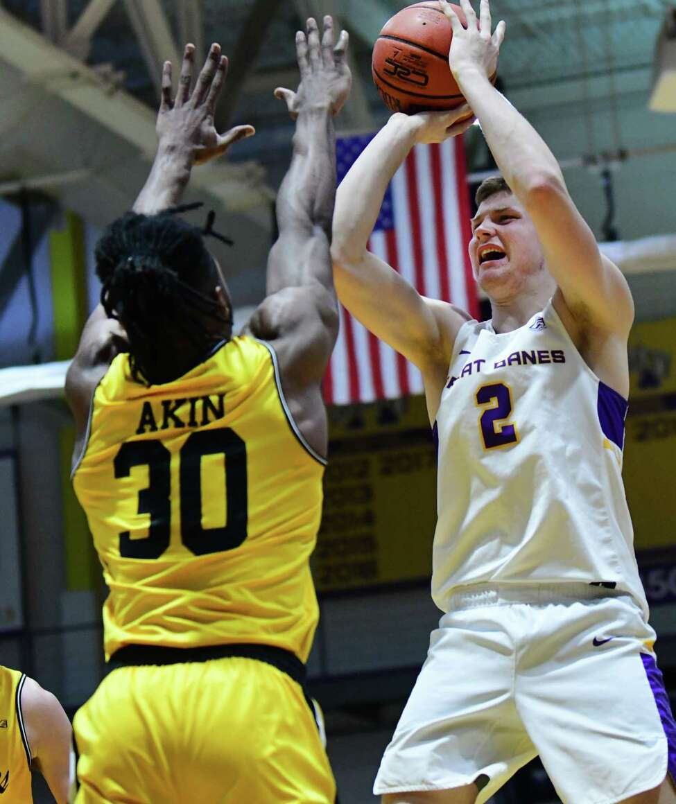 University at Albany's Trey Hutcheson takes a jump shot against Maryland-Baltimore County's Daniel Akin during a game at SEFCU Arena on Thursday, Feb. 20, 2020 in Albany, N.Y. (Lori Van Buren/Times Union)