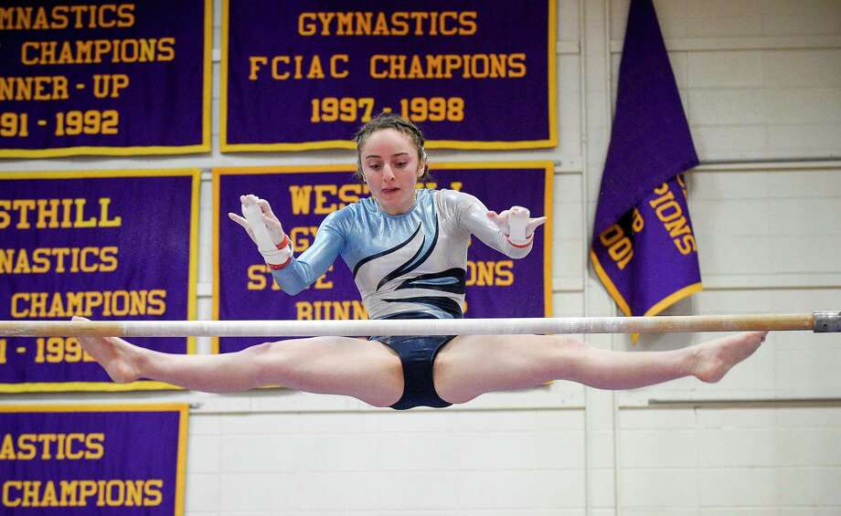 Wilton's Olivia Mannino competes on the uneven bars during the Ro Carlucci FCIAC Championships for gymnastics at Westhill High School on Feb. 15, 2020 in Stamford, Connecticut. Photo: Matthew Brown / Hearst Connecticut Media / Stamford Advocate