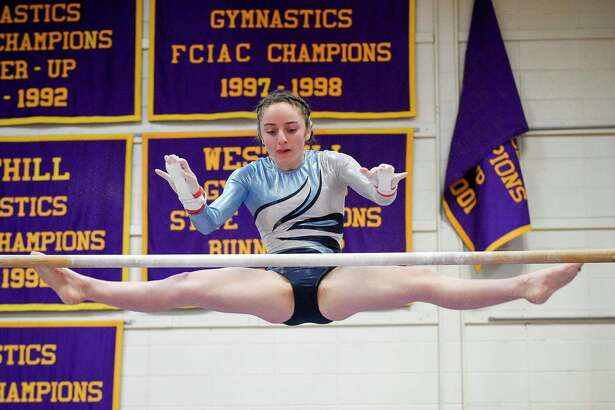 Wilton's Olivia Mannino competes on the uneven bars during the Ro Carlucci FCIAC Championships for gymnastics at Westhill High School on Feb. 15, 2020 in Stamford, Connecticut.