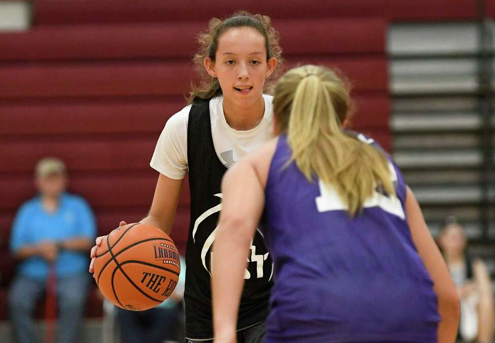 Next Big ThingsA?• Sophie Phillips of Cambridge moves the ball against Power Up's Sydney Hart of Glens Falls during a Empire State Takeover girls' basketball league game Wednesday, July 17, 2019, at Union College in Schenectady, N.Y. (Hans Pennink / Special to the Times Union)