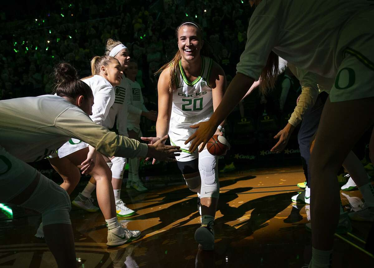 Oregon's Sabrina Ionescu take the court during team introductions before an NCAA college basketball game against South Dakota State in Eugene, Ore., Sunday, Dec. 8, 2019. (AP Photo/Chris Pietsch)