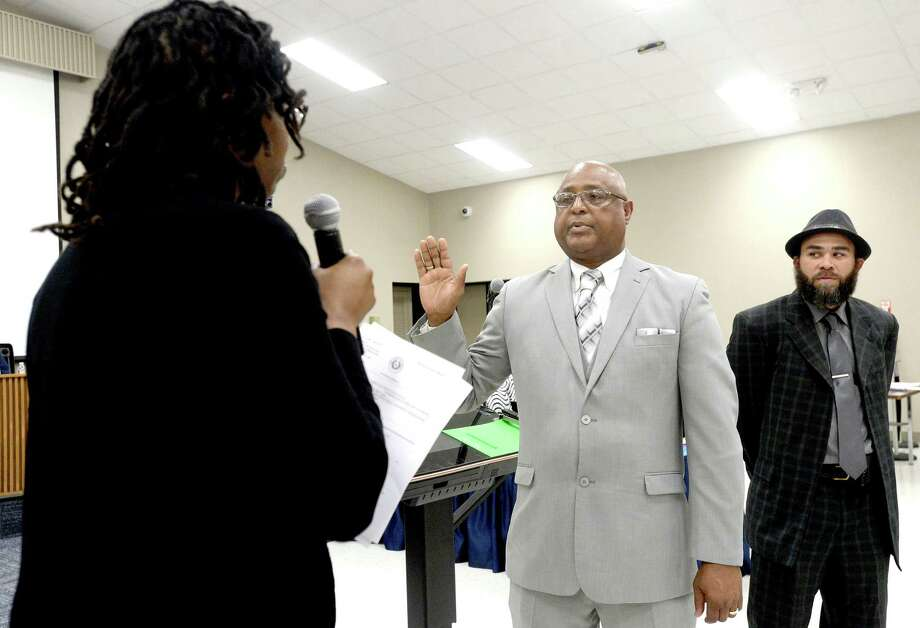Beaumont ISD swears in new trustees Robert Dunn (left) annd Kevin Reece individually during its regular board meeting Thursday night. The all-local board is a first in years after being taken over by the TEA in 2014. Photo taken Thursday, February 20, 2020 Kim Brent/The Enterprise Photo: Kim Brent / The Enterprise / BEN