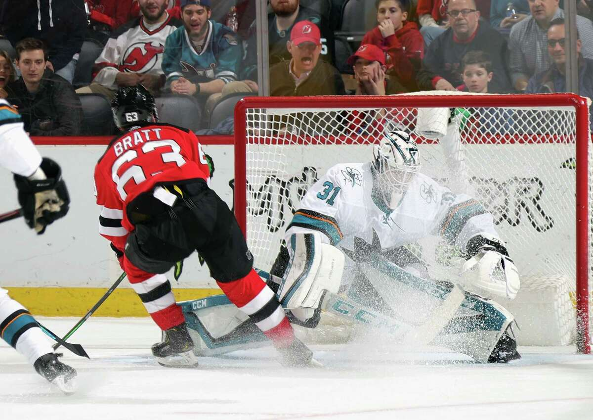 NEWARK, NEW JERSEY - FEBRUARY 20: Jesper Bratt #63 of the New Jersey Devils scores on Martin Jones #31 of the San Jose Sharks at 16:15 of the second period at the Prudential Center on February 20, 2020 in Newark, New Jersey. (Photo by Bruce Bennett/Getty Images)