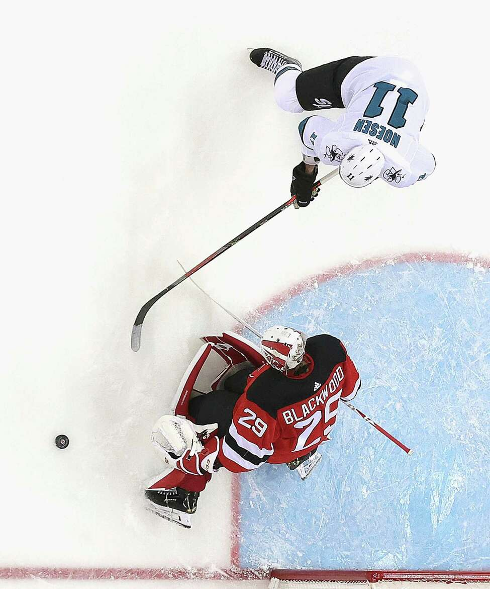 NEWARK, NEW JERSEY - FEBRUARY 20: Mackenzie Blackwood #29 of the New Jersey Devils makes the second period save on Stefan Noesen #11 of the San Jose Sharks at the Prudential Center on February 20, 2020 in Newark, New Jersey. The Devils defeated the Sharks 2-1. (Photo by Bruce Bennett/Getty Images)