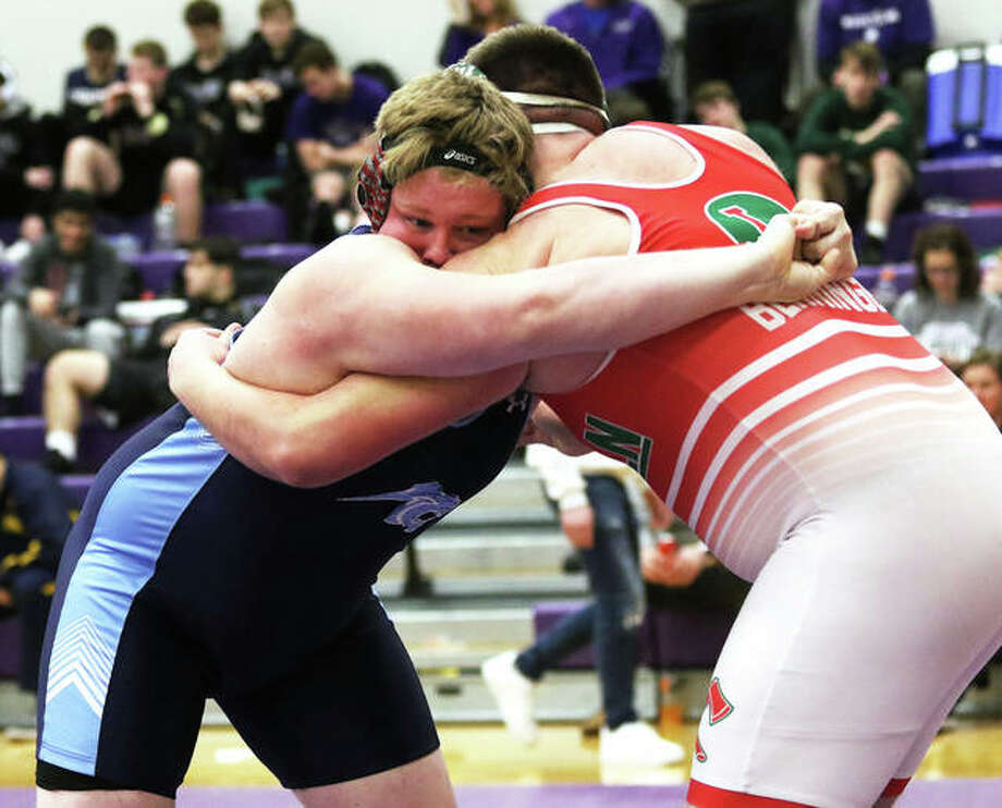 Jersey's Wyatt Daniels (left) wrestles Lincoln's Jake Benninger during a consolation semifinal at 285 pounds on Saturday at the Mascoutah Class 2A Sectional. Daniels won by fall and went on to place third in the sectional and earn his first trip to state. Photo: Greg Shashack / The Telegraph