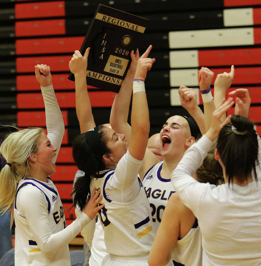 CM seniors Anna Hall (middle right) and Kourtland Tyus (middle left), sophomore Kelbie Zupan and teammates celebrate with the regional plaque Thursday night in Troy. Photo: Greg Shashack / The Telegraph