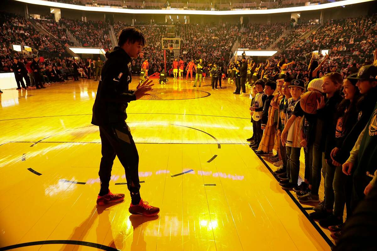 Jordan Poole engages with fans at halftime during a game against the Chicago Bulls on November 27, 2019 at Chase Center in San Francisco, Calif..