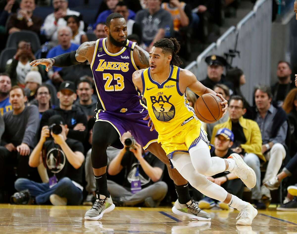 Golden State Warriors' Jordan Poole drives against Los Angeles Lakers' LeBron James during Lakers' 125-120 win in NBA game at Chase Center in San Francisco, Calif., on Saturday, February 8, 2020.