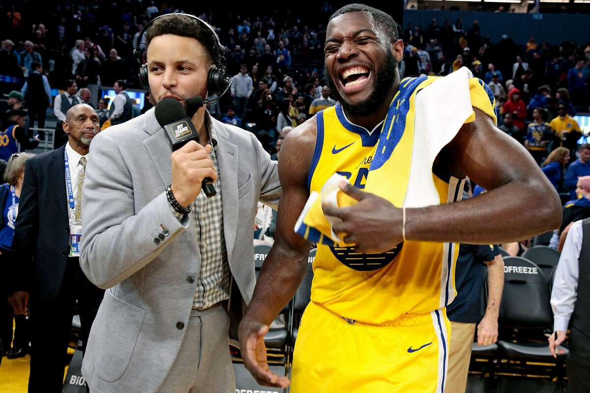 From left: Golden State Warriors guard Stephen Curry taking a role as an NBC sports analyst interviews Warriors forward Eric Paschall (7) following the NBA game at Chase Center, Saturday, Jan. 18, 2020, in San Francisco, Calif. The Warriors won 109-95 against the Orlando Magic.