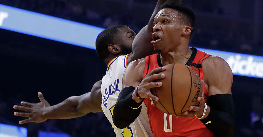 Houston Rockets' Russell Westbrook, right, looks to shoot past Golden State Warriors' Eric Paschall in the first half of an NBA basketball game Thursday, Feb. 20, 2020, in San Francisco. (AP Photo/Ben Margot) Photo: Ben Margot/Associated Press / Copyright 2020 The Associated Press. All rights reserved.