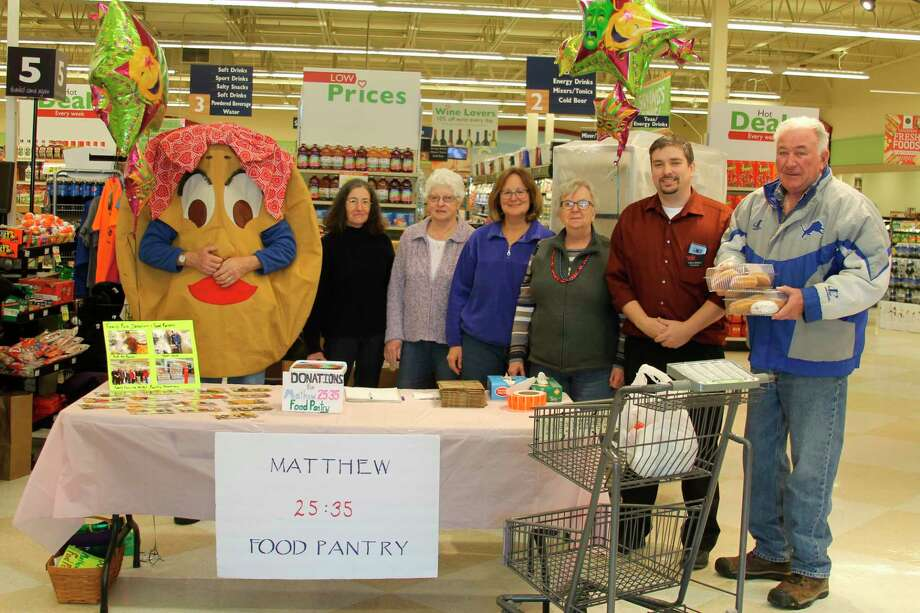 """The Matthew 25:35 Food Pantry volunteers host the annual """"Pack the Paczki"""" food drive at Family Fare in Manistee to raise food for the pantry. This year's event will be held on Feb. 25. (File Photo)"""