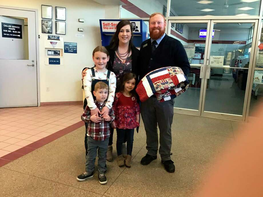 Jake, Zoey, Vivian, Rosalyn and Tom Kindell pose with a Quilt of Valor. (Photo provided)
