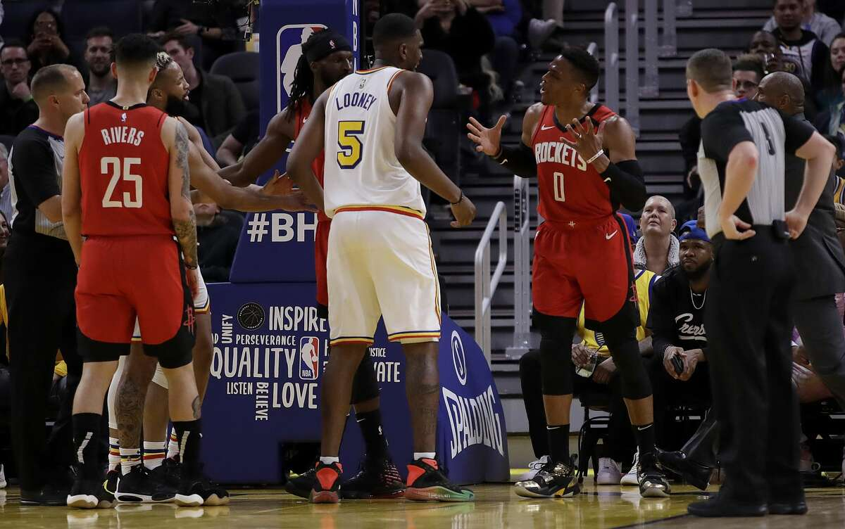 Houston Rockets' Russell Westbrook (0) gestures while speaking to Golden State Warriors' Kevon Looney (5) in the fourth quarter of an NBA basketball game Thursday, Feb. 20, 2020, in San Francisco. Westbrook was ejected after receiving a second technical foul in the fourth quarter.