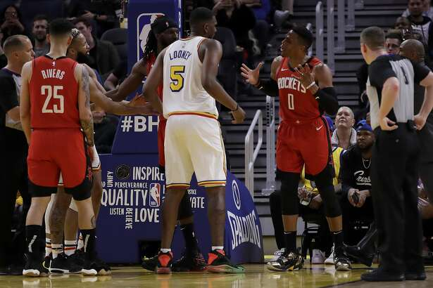 Houston Rockets' Russell Westbrook (0) gestures while speaking to Golden State Warriors' Kevon Looney (5) in the fourth quarter of an NBA basketball game Thursday, Feb. 20, 2020, in San Francisco. Westbrook was ejected after receiving a second technical foul in the fourth quarter. (AP Photo/Ben Margot)