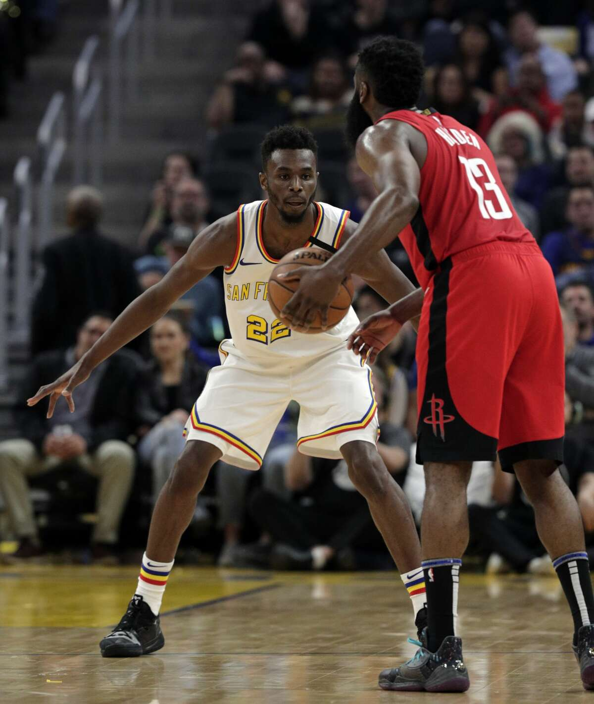 Andrew Wiggins (22) defends against James Harden (13) In the first half as the Golden State Warriors played the Houston Rockets at Chase Center in San Francisco, Calif., on Thursday, February 20, 2020.