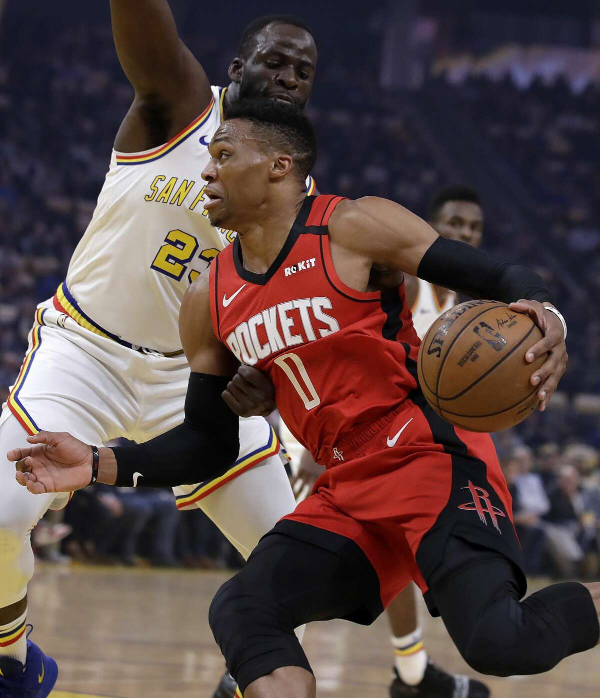Houston Rockets' Russell Westbrook (0) drives the ball against Golden State Warriors' Draymond Green, left, during the first half of an NBA basketball game Thursday, Feb. 20, 2020, in San Francisco. (AP Photo/Ben Margot)