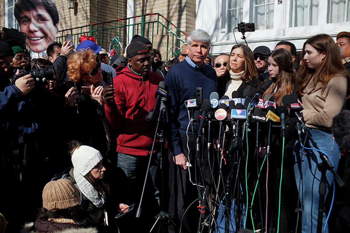 """Former Gov. Rod Blagojevich and his family talk with reporters Wednesday outside his Chicago home. Blagojevich emerged from his brick bungalow, coatless, tieless and remorseless, decrying a broken and corrupt justice system, speaking of his """"exile"""" in prison, thanking President Donald Trump for commuting his sentence after eight years and insisting that he had done nothing illegal."""