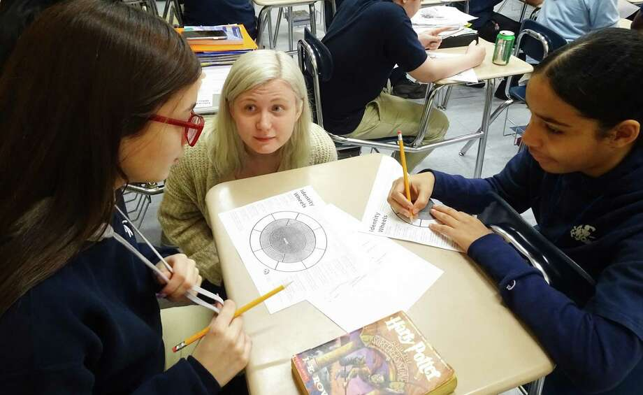 Danielle Todd, center, new lead adviser of the Ansonia High School's Human Relations Club, with two student club members. Photo: Contributed Photo