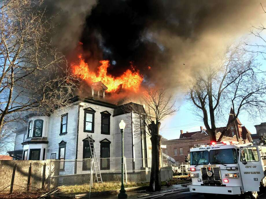 The third floor of a building at 1303 Chapel Street in New Haven is ablaze on Christmas morning December 25, 2019. The home under renovation was the former home of Walter Camp and recently sold for $1.2 million on November 19, 2019. Photo: Contributed Photo