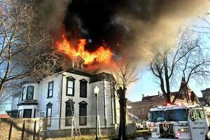 The third floor of a building at 1303 Chapel Street in New Haven is ablaze on Christmas morning December 25, 2019. The home under renovation was the former home of Walter Camp and recently sold for $1.2 million on November 19, 2019.