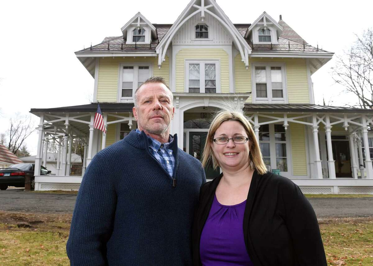 Rick DelValle and his wife, Jess, photographed outside of The Recovery Mansion, one of A New Beginning Recovery Houses, in the Fair Haven Heights section of New Haven.