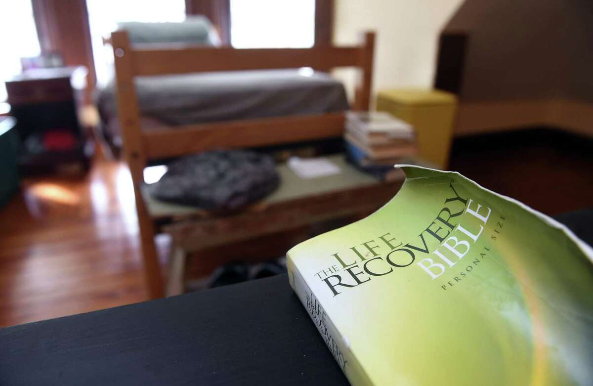 The Life Recovery Bible sits on a table in a third floor bedroom of the Recovery Mansion in the Fair Haven Heights section of New Haven on February 3, 2020.