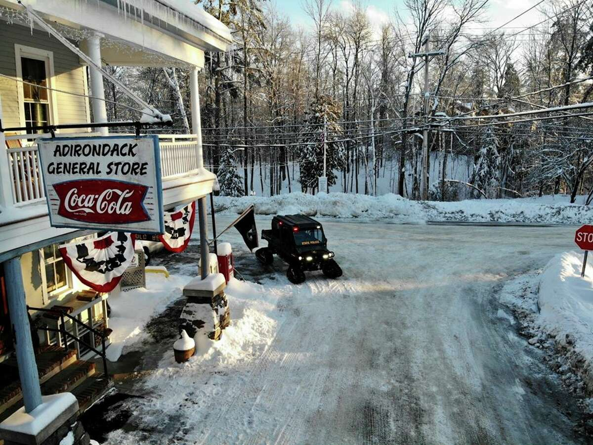 """""""Troopers took to the snow-covered areas around Lake George to check on residents that may need assistance after snow and ice conditions left them snowbound and without power,"""" the State Police say of this photo posted in February. """"Patrols used snowmobiles and UTVs to check homes and roadways."""""""