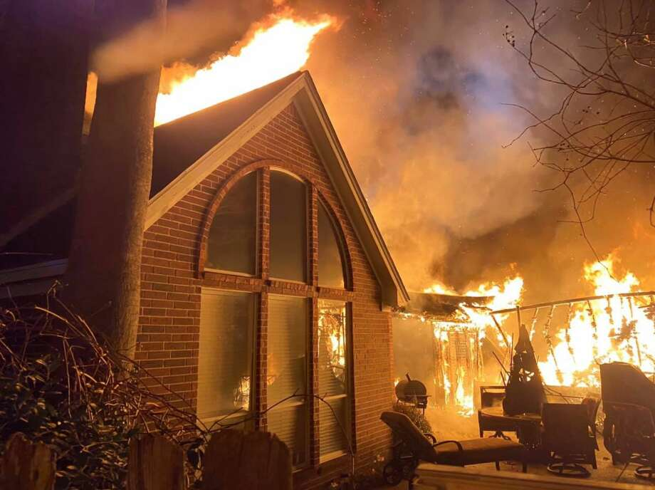 A home in The Woodlands sustains heavy fire damage after catching fire early Friday, Feb. 21, 2020. Photo: Courtesy The Woodlands Professional Fire Fighters Association