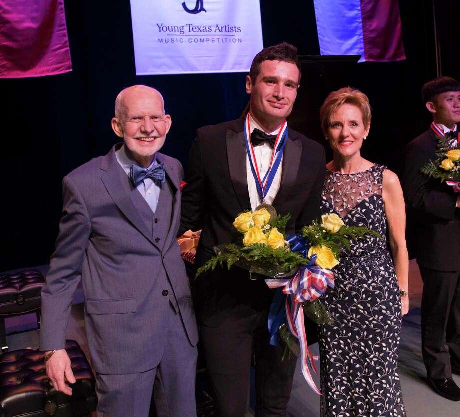 YTA Founder Jim Pokorski, 2019 Grand Prize winner Artem Kuznetsov, and YTA President/CEO SusiePokorski. Photo: Photo Courtesy The Young Texas Artists Competition