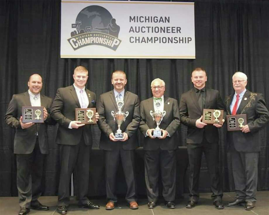 Jason Clark, third from the left, stands in the winner's circle at the Michigan Auctioneers Association's annual conference Jan. 30 in Mount Pleasant.He competed against 16 contestants to win the 2020 Michigan Auctioneer Championship. (Courtesy photo/Jason Clark)